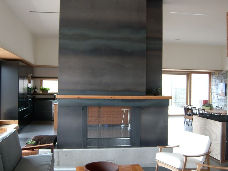 Raw Steel Cladded Fireplace With Wood Mantle