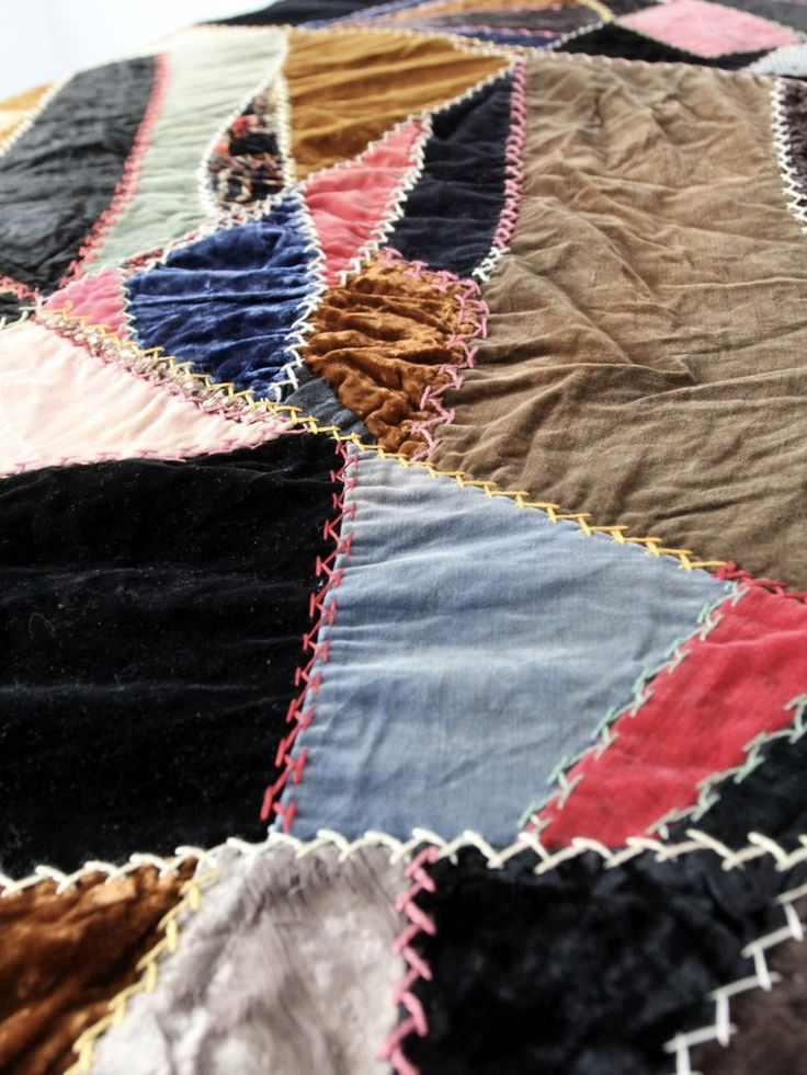 "Circa 1910s An antique mixed textile ""crazy"" quilt. This style of quilt became in fashion during the late Victorian. The hand-stitched quilt features a variety of textiles, primarily in velvet and woo"