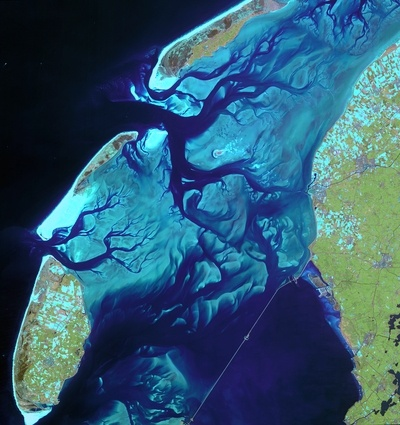 This satellite image shows the ever-moving sandbanks in the shallow Wadden Sea in the north of the Netherlands. Declared a UNESCO World Heritage Site last year, this unique region is one of the largest wetlands in the world.