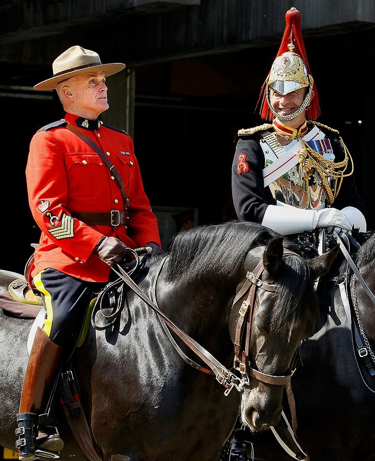 The RCMP have been invited by the Queen to act as her personal bodyguards in the run up to the Jubilee. They're preparing for the Changing of the Queen's Guard ceremony on May 23 and 25, when they will ride alongside the Household Cavalry. (AP Photo)
