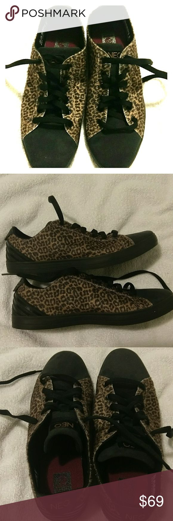 Adidas Neo leopard faux fur shoes Women's 7.5 Adidas Neo leopard print faux fur suede shoes. These were a sample, not sold in stores. Black suede rounded toe. Burgandy interior. The sides have faux fur cheetah print that has a copper sheen. Black shoelaces. In excellent unused condition. US women's 7.5, UK 6. Unique. Comfortable. Dress up. Trainers. Sneakers. Cheetah, leopard, copper, Adidas Shoes Sneakers