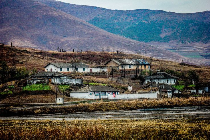 Travel tips to Visit North Korea on a budget. #Korea #NorthKorea #asia #pyongyang #travel #backpacking #statue #highway #road #countryside