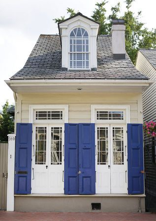 Adorable Creole cottage in The New Orleans French Quarter.  please, please let me change the color of these shutters...