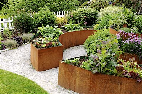 Repurposed steel raised beds, coated inside with natural rubber product to prevent leaching.