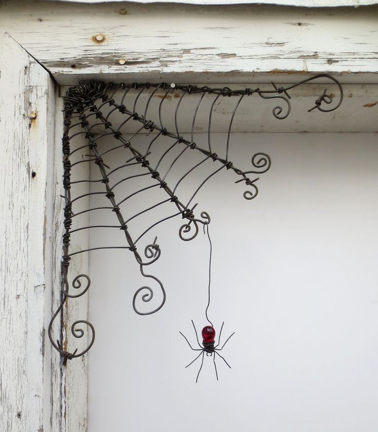 "Czechoslovakian Red Spider Dangles From 12"" Barbed Wire Corner Spider Web. $51.00, via Etsy. - need to make my own.."