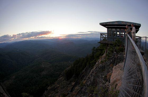 Perched atop the edge of a rocky cliff in the Umpqua National Forest, Acker Rock Lookout (Fire Lookout)  Season Dates: Aug 1 - Nov 13