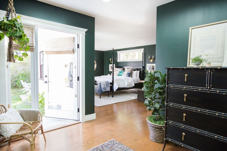 At first we had our room painted white, but after about 6 months of living/sleeping in the space it didn't feel right. We went against the trend and went GREEN, Benjamin Moore Essex Green to be exact. I couldn't be happier with the result and the darker color allows us to sleep longer hours!