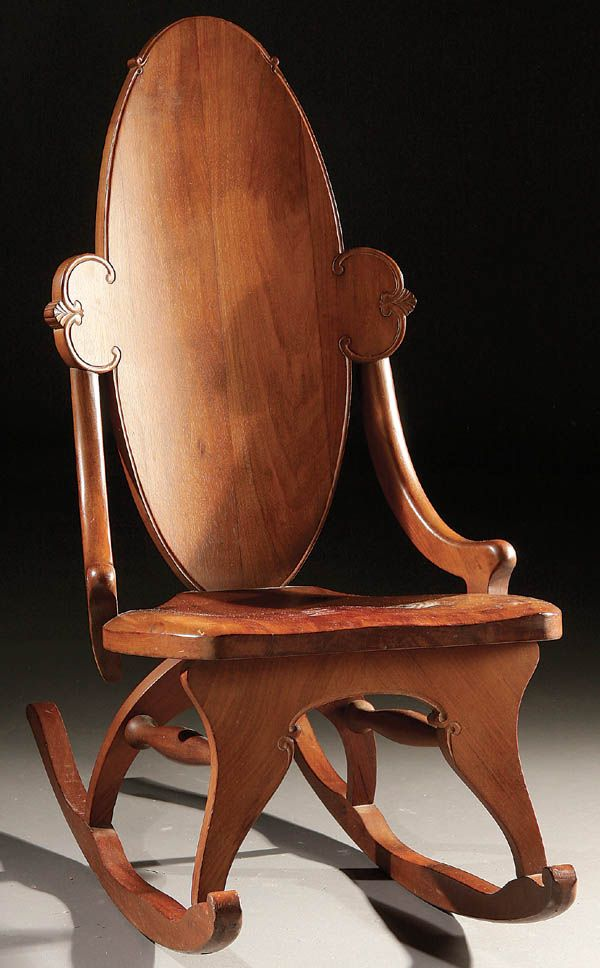 AN ART NOUVEAU WALNUT SEWING ROCKER late 19th century with shaped oval back and hip rests.
