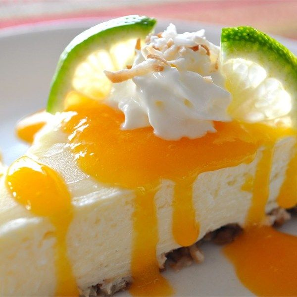 """Coconut-Lime Cheesecake with Mango Coulis 