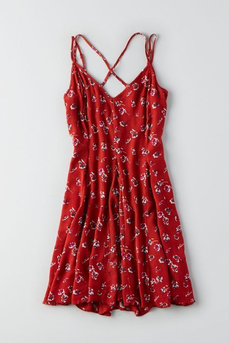 Take your look from day to night. This dress features pretty, strappy details and a free-spirited print. Shop the AEO Cross-Back Flowy Dress from American Eagle Outfitters. Check out the entire American Eagle Outfitters website to find the best items to pair with the AEO Cross-Back Flowy Dress .