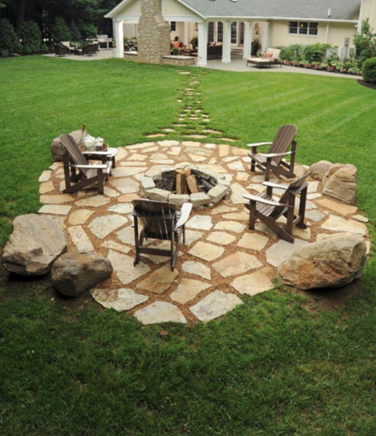 I like the stone patio around this