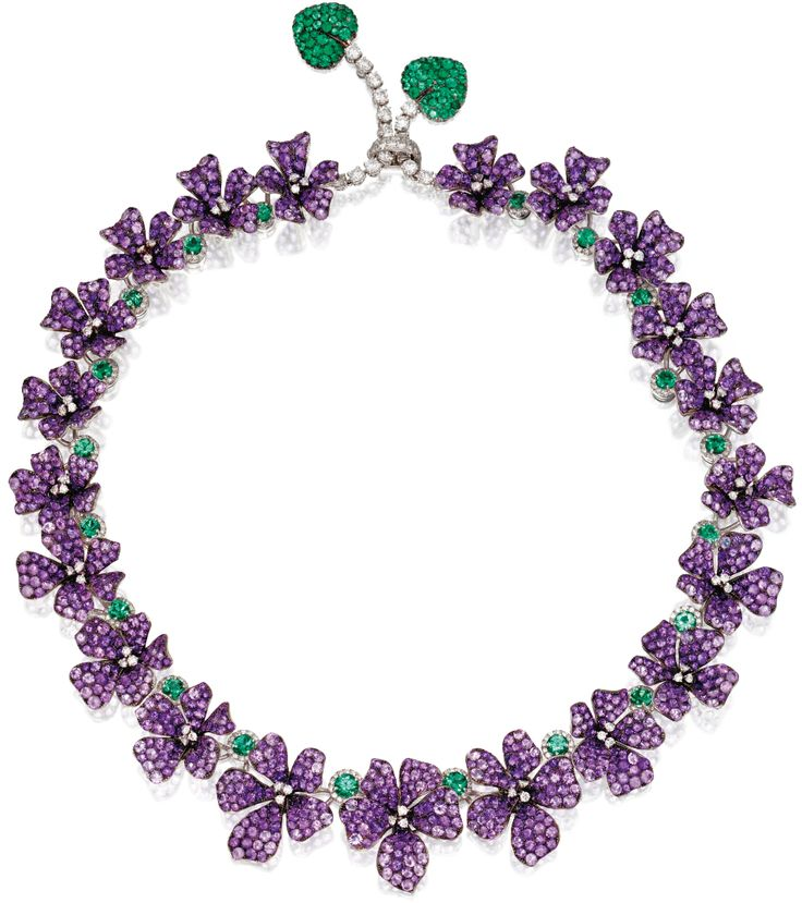 Michele della Valle ' Amethyst, diamond, and Emerald Violet Necklace designed as a graduated line of violets centered by round Diamond and their petals are set with 23.95 carats of round Amethysts. The flowers are spaced by round Emeralds framed with round Diamonds. The clasp suspends two vines set with round Diamonds and completed by leaves set with round Emeralds. The total diamond weight is 4.34 carats, and total emerald weight is 5.68 carats.