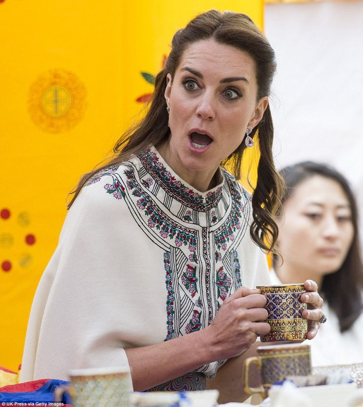 The Duchess of Cambridge watches young people playing a game of archery, the national sport of Bhutan