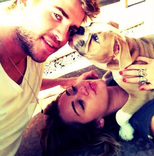 I'm sorry. But he is too fine and manly for her. She should be with Justin Beiber. Not a grown ass Helmsworth man . LOL. Cute puppy!