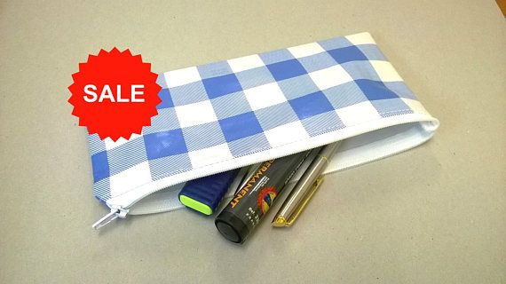 This is a lovely large pencil case in blue and white checks Long white zip closure Perfect for holding pens and pencils Measures approx - 9 inches x 4 inches (23 cm x 11 cm) Ideal for school as lightweight but also perfect for the office or home Made in pvc vinyl and can the outer can be wiped clean Inner seams have been double stitched for added strength I have made this item individually with much care I will post the next working day  You may also like to see my other pencil cases…