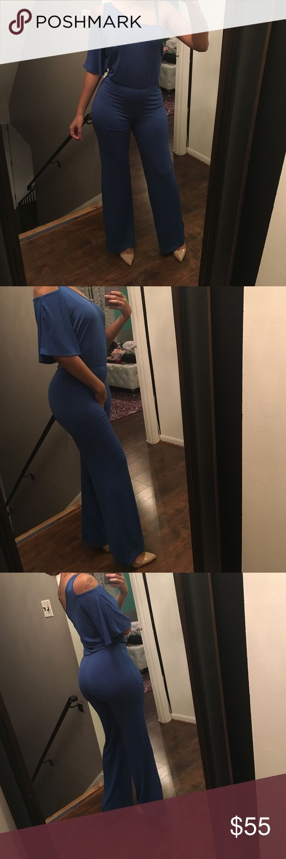 Blue one piece pants jumpsuit Pretty blue stretchy pants jumpsuit. One side has spaghetti strap the other is short sleeve. Wider leg towards the bottom Pants Jumpsuits & Rompers