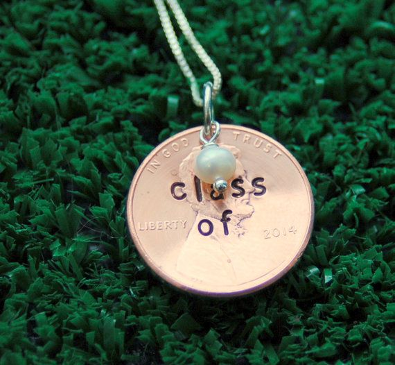 The perfect gift for a 2014 grad! Genuine penny is hand stamped, accented with a freshwater pearl, and arrives on 18 inch sterling silver chain.