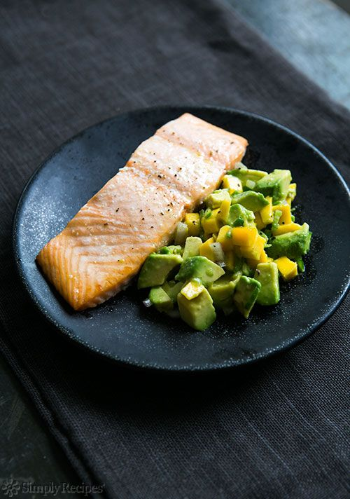 Baked Salmon with Avocado Mango Salsa ~ Oven-baked salmon fillets served with avocado, mango, chile, lime salsa. #paleo #healthy On SimplyRecipes.com