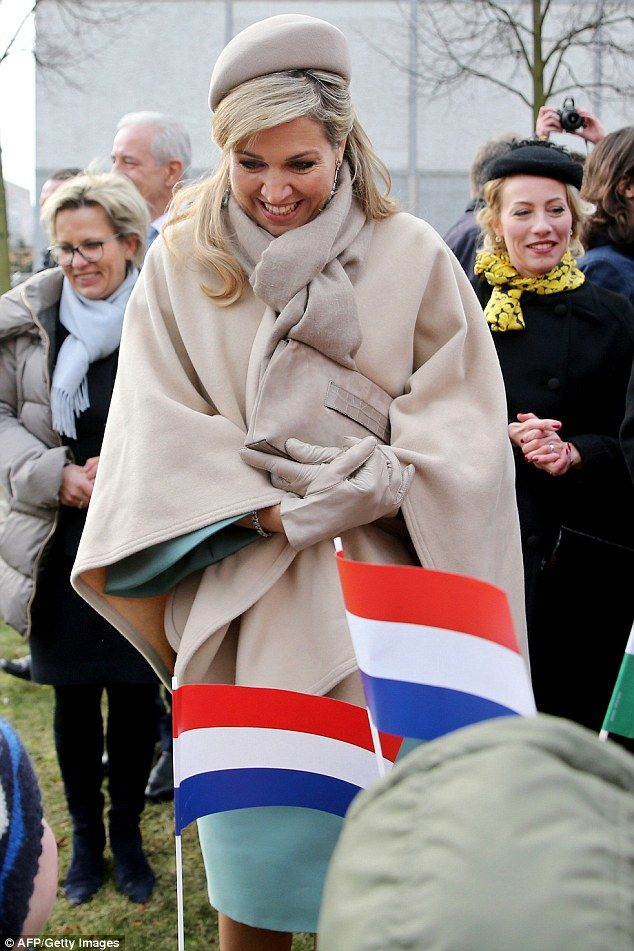 Queen Maxima of the Netherlands greets children as she visits buildings from the GDR times and smiles at the warm welcome she receives