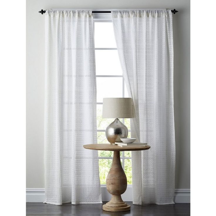 These lovely cotton eyelet curtain panels bring a little romance to your views. Inspired by classic tilework motifs.