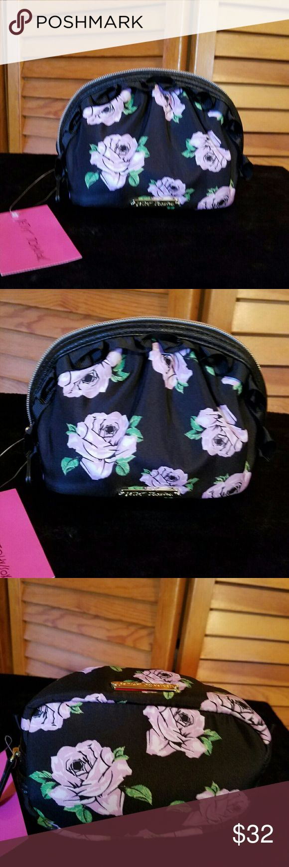 """🌹NWT- BETSEY JOHNSON FLORAL DESIGN COSMETIC BAG 🌹NWT- BETSEY JOHNSON FLORAL RUFFLE DESIGN COSMETIC BAG THIS IS AN ABSOLUTE BEAUTIFUL BAG FROM BETSEY ONE OF MY FAVORITES & RARE FIND❤  APPROXIMATE SIZE 7""""WX 5.5""""H   🌹NWT-BRAND NEW WITH TAGS - NEVER USED 🌹100% AUTHENTIC 🌹SAME DAY SHIPPING 🌹NO TRADES  🚫PLEASE READ MY CLOSET RULES AND FOLLOW PLEASE NO RUDE COMMENTS LETS ALL BE RESPECTFUL TOWARDS ONE ANOTHER 😊  💋www.shopaprilsboutique.com💋 Betsey Johnson Bags Cosmetic Bags & Cases"""