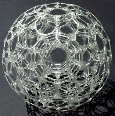 Even more beautiful and intricate is the truncated 120-cell, a 4D object made of 120 truncated dodecahedra and 600 tetrahedra. At right is shown an SLA model of an orthogonal shadow of it, about six inches in diameter. It is quite stunning to view the tunnels which penetrate it in six different directions. To make your own, just download this STL file (0.81 MB) to send to your local RP machine.