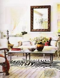French country living room with zebra print rug and galvanized metal coffee table..