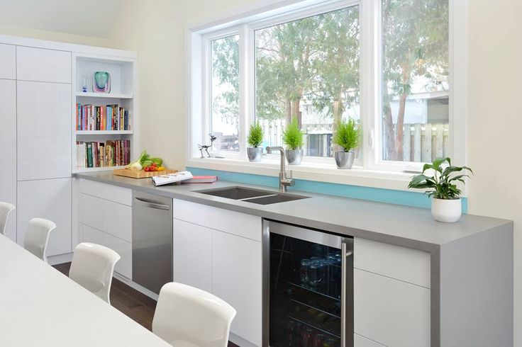 This light-filled dining area by ATD Contracting gets a functional upgrade with a prep area created out of Sleek Concrete quartz surfaces by Caesarstone. Seat us in reach of that wine fridge, please.