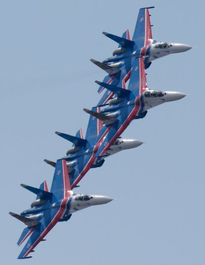 Su-27 jets from the Russkiye Vityasy, or Russian Knights aerobatics team perform during an air show at the International Maritime Defence show in St.Petersburg, Russia