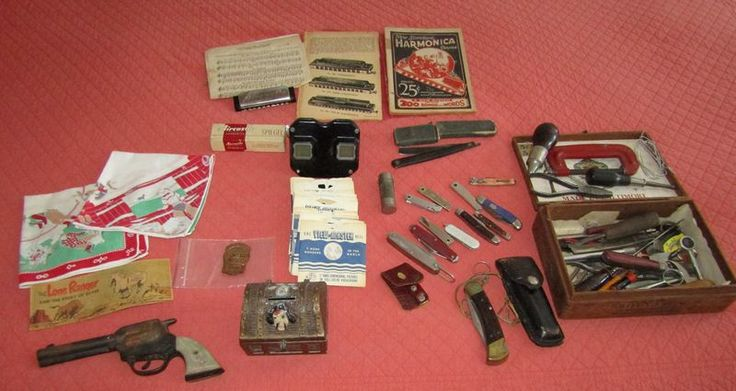 Vintage toys, knives, harmonica and music, French straight razor, leather working tools. Featuring Gene Autry cap gun (functional); Buck pocket knife and other knives; Viewmaster viewer and slides; etc.