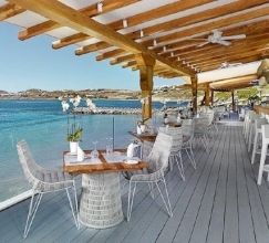 The Santa Marina Mykonos is a cosmopolitan sophisticated and stylish resort, with a unique long sandy beach and exceptional services. Located in the south west corner of the island 5 minutes drive from Mykonos Town and 10 minutes from the airport.