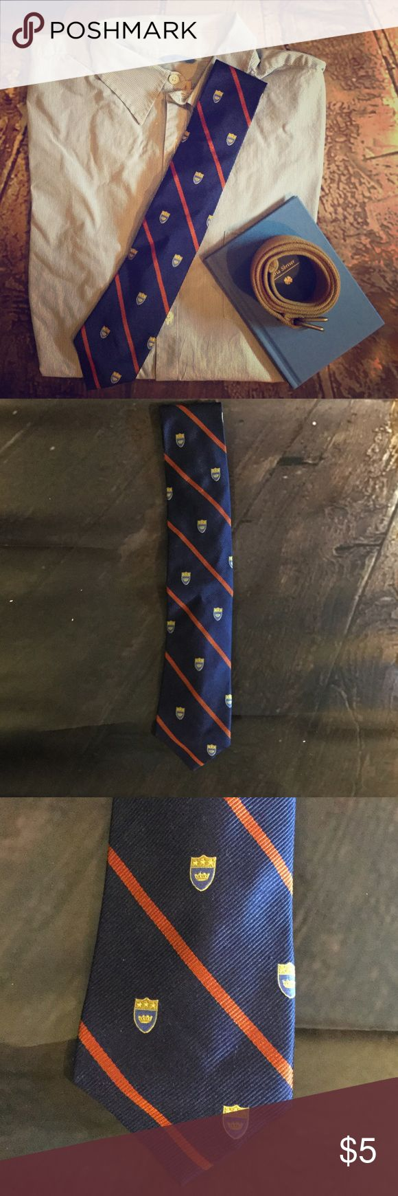 Lot of 2 Men's School Crest Tie.& Striped ONE SIZE Lot of 2 Men's Merona ties. SIZE: One Size. FABRIC: Silk. CONDITION: Worn. No Tears. No Holes. Slight wrinkles (Can easily be steamed/ironed out) 🤵 👨‍💻 $$$ Bundle! NOTE:  Lot of 2 ties are for sale, all other items are props. Merona Accessories Ties