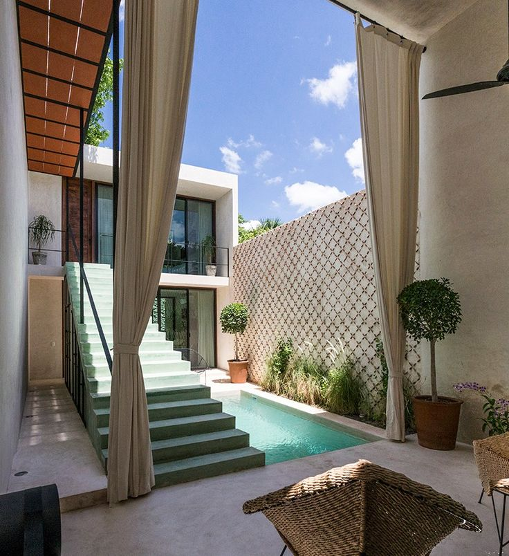 two separate volumes containing the living areas is seamlessly connected by a courtyard featuring a pool and terrace.