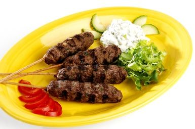 Delicious Middle Eastern Kebabs: Kofta Kebabs with Tzatziki and Salad