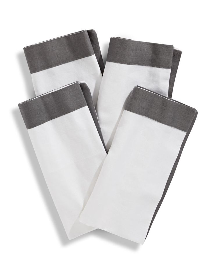 This set of four Bedford napkins brings effortless refinement to your dining table. The solid border accent lends a sophisticated look to everyday dining and to your next dinner party. Part of a collection. Available in grey, taupe and white.