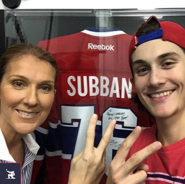 Remember him? Everyone does, but you'd never know it by the picture. That attractive young man standing next to Celine Dion is her 14-year-old son Rene Charles Angelil, the boy once known primarily for his long, flowing hair. That boy is now becoming a full-fledged man and looking mighty fine. On Oct. 13, Celine and her son posed in front of a jersey of Canadian hockey player P.K. Subban. It's the first time we've seen him in ages. Recently, Celine mentioned that her son is a blossoming…