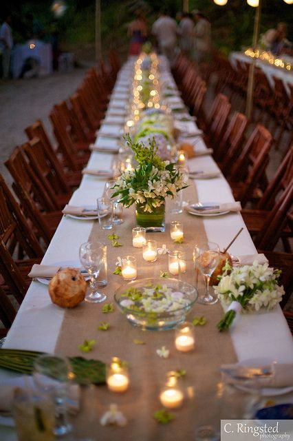Little candles on a rustic wedding table - just beautiful.  I'd add in some olive leaves.