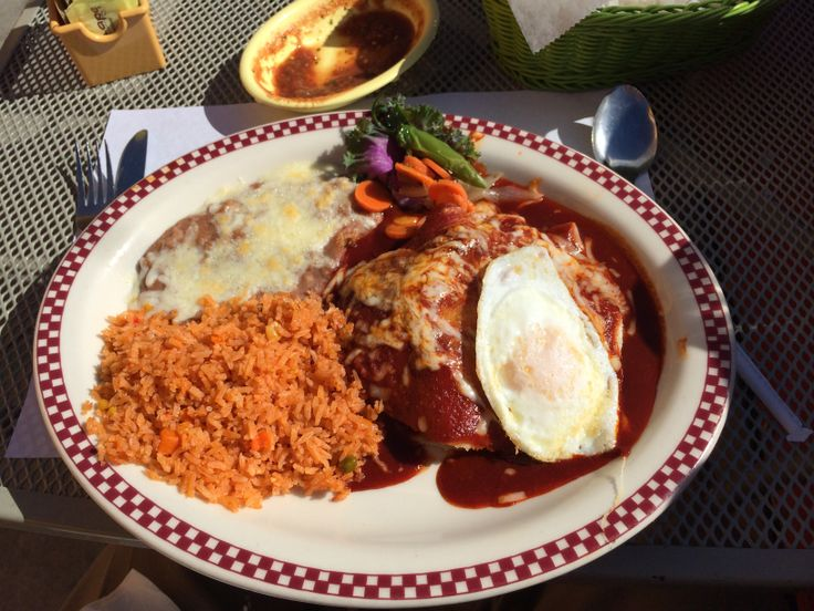 *Special* The Enchilada Nuevo Mexico - a layered enchilada with seasoned ground beef, cooked with corn kernels, potatoes, dried New Mexico chile powder, topped with dried chile guajillo sauce, finished with melted jack cheese and topped w/ an egg cooked to order.