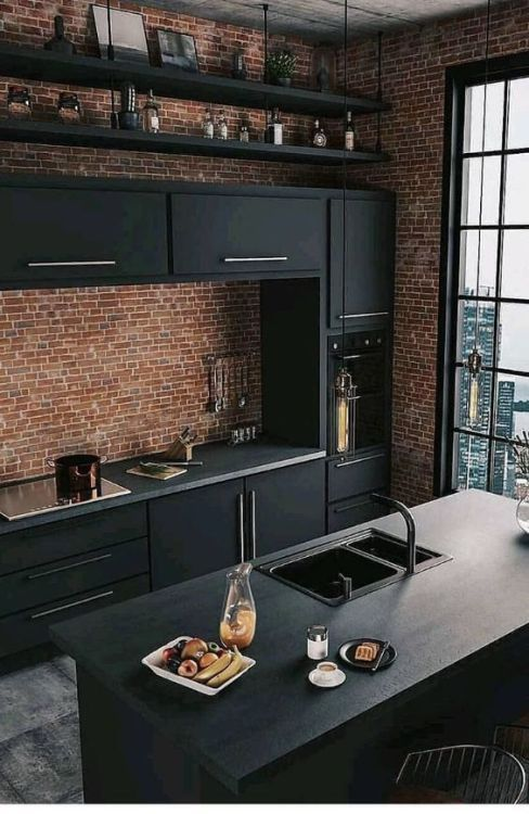 This kitchen is industrial modern. The sleekness of the counters and cabinets, t…