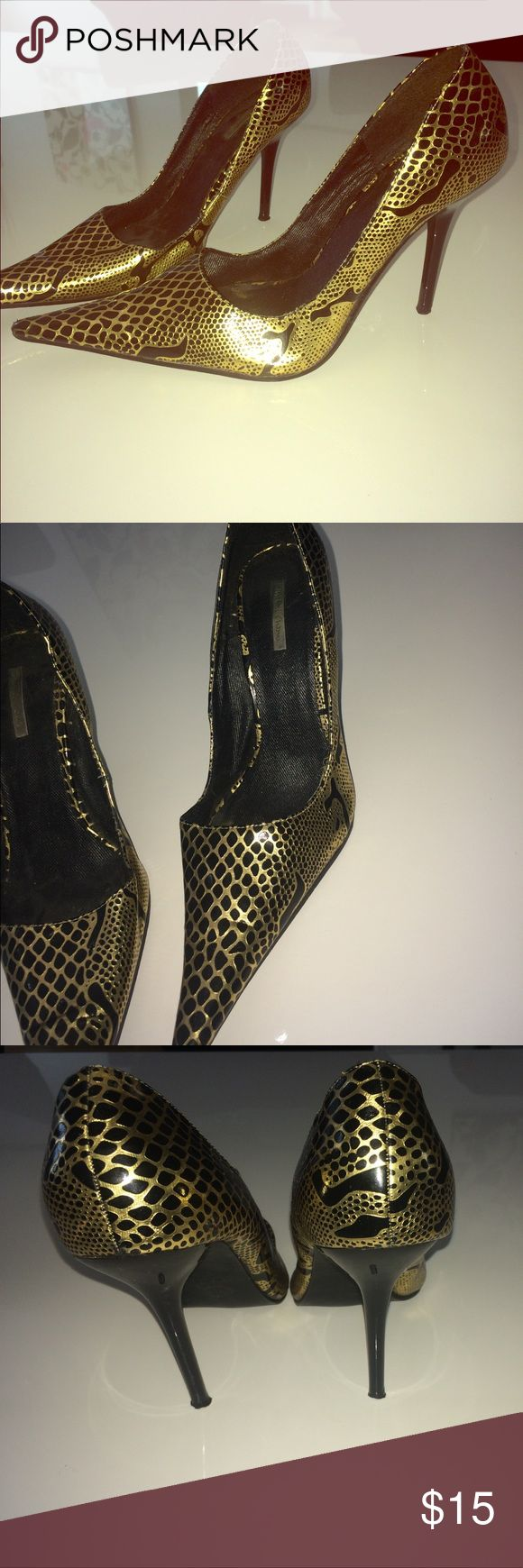 Black and gold pumps Black and gold snake skin pumps. Great condition. Size 7.... Michael Antonio Shoes