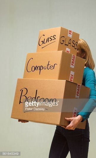 Stock Photo : Student carrying removal boxes