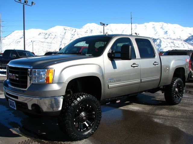Silver Grey GMC Sierra Lifted Truck