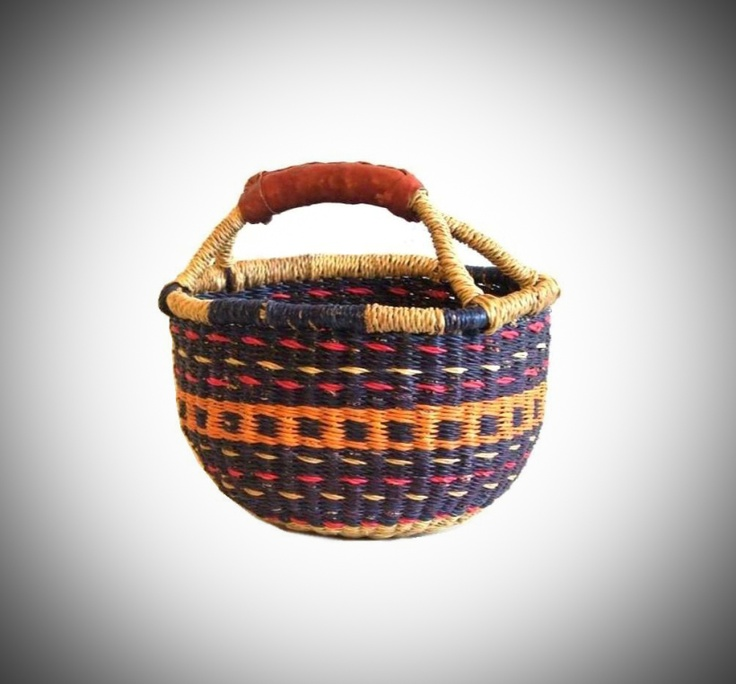One of our most loved items!  Our baskets are hand-woven from the elephant grass which grows in the rich flood plains of the White Volta near Bolgatanga, Northern Ghana     Shape to your preference by submerging in water for a few minutes to soak the elephant grass and make it malleable. Then simply adjust to the shape you desire. The durable leather handles can be kept in premium condition by applying a little clear boot polish or leather conditioner from time to time        $16