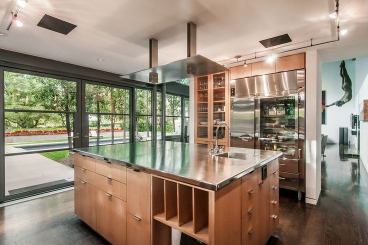 Dream kitchen alert: From the island with serious storage on four sides to the industrial refrigerator, you've got everything you need to whip up a gourmet dinner.