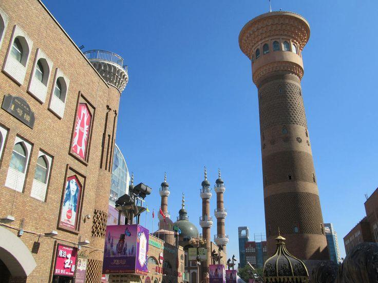 A replica of the Kalon Minaret from Bukhara, Uzbekistan, towers over the Erdaoqiao Market and Grand Bazaar in Urumqi, Xinjiang, China.