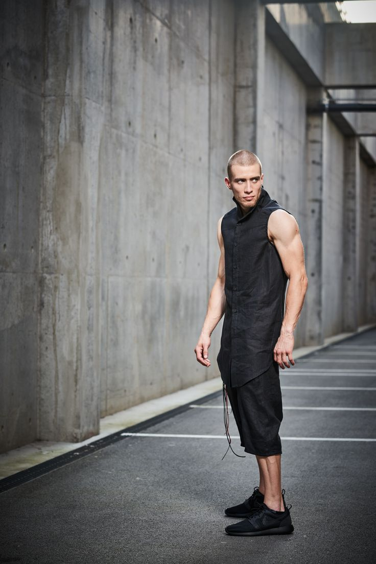 Shop Linen Sleeveless Black Shirt – by Powha, €129.00 at Vathir.com | Our reversed high_low design, inspired by a voltaic arc, has a vaulted back hem, so you can reach your back and side pockets without compromising your shirt's length. It also has an upright futurist collar and side seams that mirror the natural position of the arms. We cut around the main concept of a shirt, by adding our modern, dark, asymmetrical aesthetic__