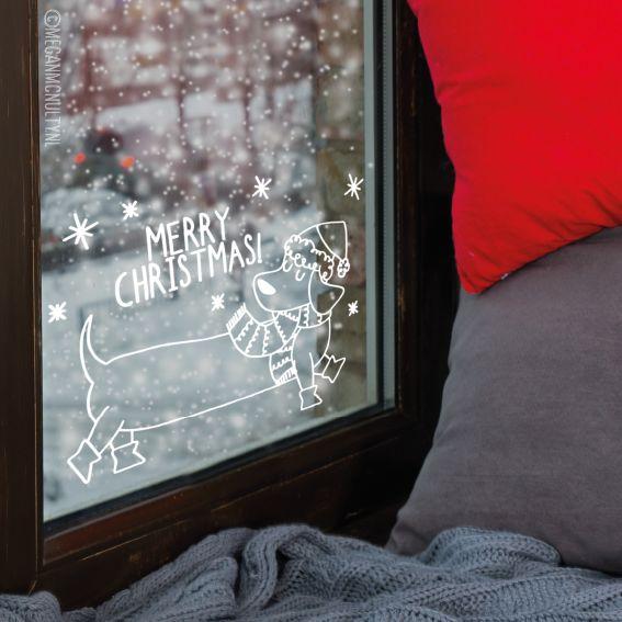 Een vrolijke kerstmis #raamtekening, geïllustreerd door Megan McNulty. Voor de echte hondenliefhebber maar ook de rest, want wie wil er nou geen teckel met kerstmuts op hun raam hebben staan?