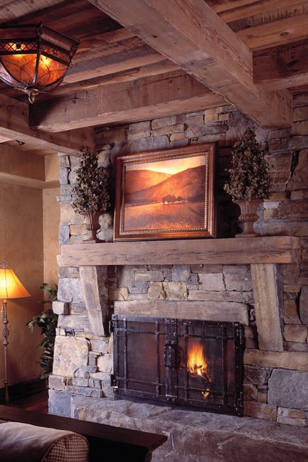 Stone fireplace with wood beams