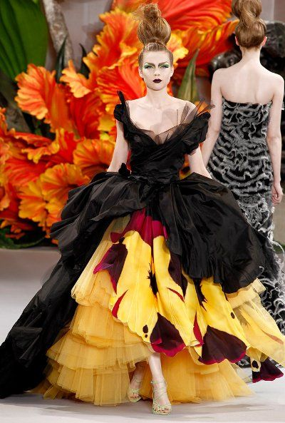Christian Dior Haute Couture Gowns are big, dreamy, beautiful, colorful and completely mesmerizing owing to cinched waists and layers and layers of detail and textures.