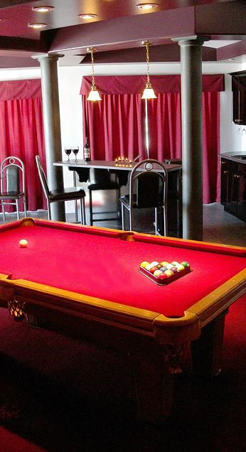 """The spaciousness of this cabin adds to its elegance. A game of pool maybe just what is needed before your full course """"Intimate Dinner For T..."""